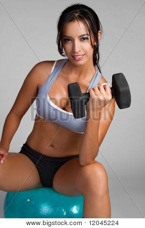 Happy young fitness woman exercising