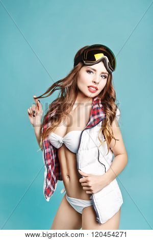 Portrait Of Young Sexy Girl In Bikini With Mask On Head On Blue Background. Studio Photography. Idea
