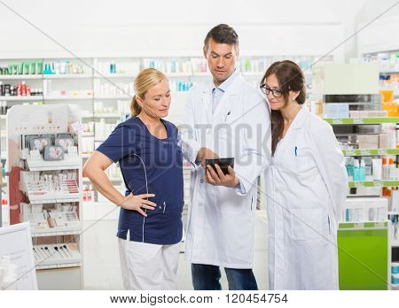 Assistant Using Digital Tablet With Pharmacists