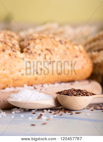 Two Wooden Spoons With Salt And Flax Seeds