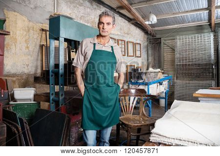 Confident Worker Standing With Hands In Pockets At Factory