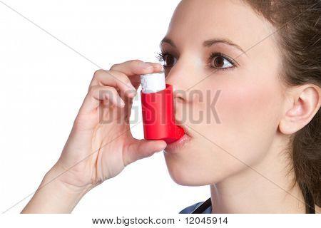 Pretty girl holding asthma inhaler