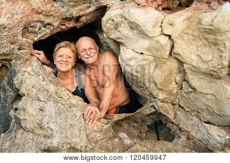 Senior Happy Couple Having Fun At The Entrance Of Kayangan Cave In Coron - Adventure Travel
