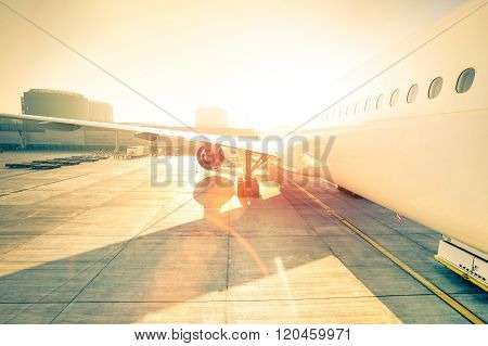 Generic Airplane On Terminal Gate Ready For Takeoff - Modern International Airport At Sunset