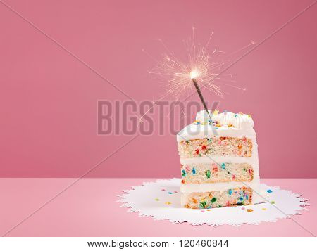 Slice Of Birthday Cake With Sparkler