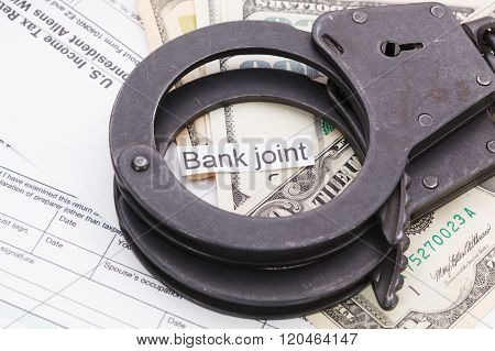 Handcuffs And Money With Sign – Bank Joint On Tax Form Background