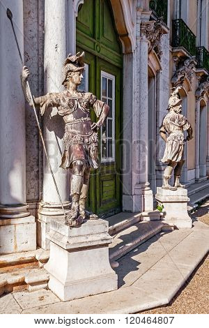 Queluz, Portugal. John Cheere lead sculptures by the doors of the  Cerimonial Facade on the Queluz Royal Palace. Formerly used as the Summer residence by the Portuguese royal family.