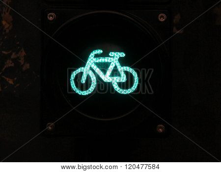 Green Colored Traffic Light With Bike Sign For Cyclists Close Up