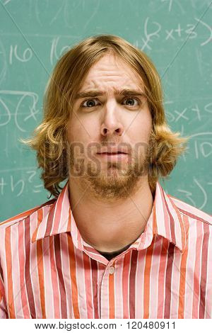 Male student looking confused