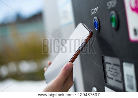 Customer paying though NFC on parking machine