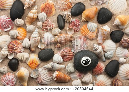 Pyramid Yinyang Stands On Seashells And Stones