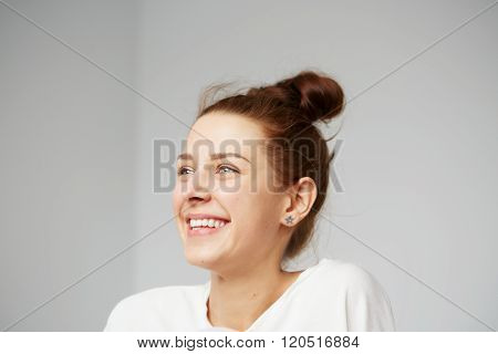 ?ute Smiling Woman. Closeup Portrait Woman Looking Happy. Sitting On The Floor And Relaxing In The B
