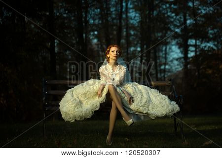 Pretty Bride On Bench In Forest