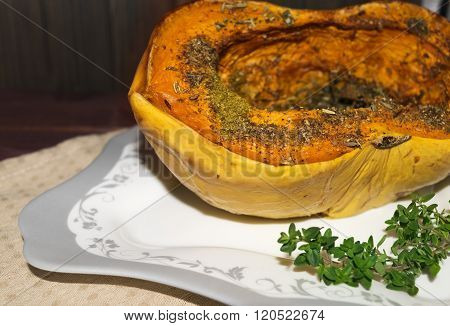 Pumpkin Baked With Spices And Decorated With Thyme toned selective focus