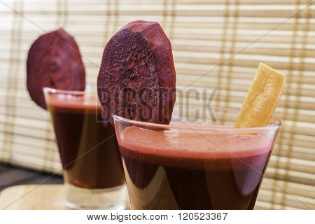 Fresh Carrot And Beetroot Juice In Glass Decorated With Carrot And Beetroot Slices On Wooden Tray An