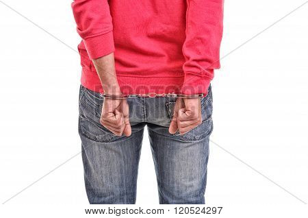 Young Man With Pink Blouse Handcuffed With Hands Behind His Back