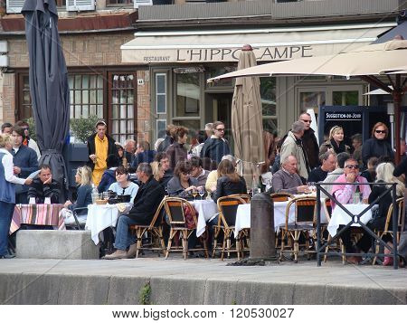 People Sitting On The Terrace Of The Restaurant In France