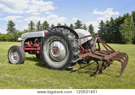 Old Ford tractor with field cultivator