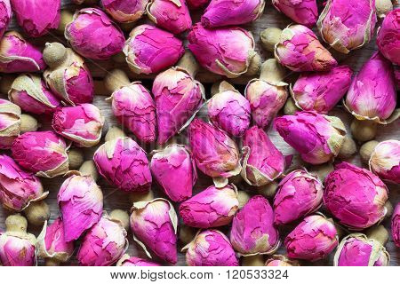 Dry Rose Buds Tea Background. Top View.