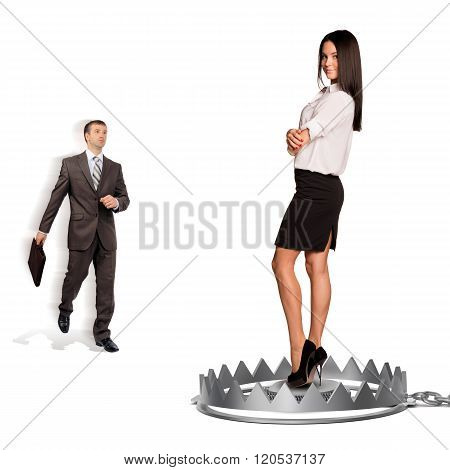 Businessman with woman in bear trap