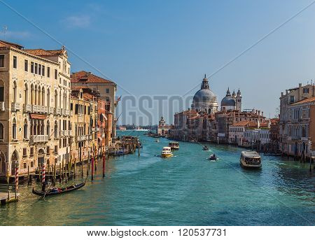 VENICE ITALY - 15TH MARCH 2015: A view of buildings along the Giudecca and Dorsorduro Districts of Venice. Various boats can be seen.