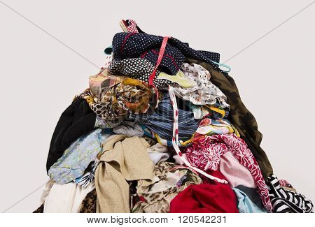 Untidy cluttered wardrobe with colorful clothes and accessories. poster