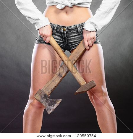 Closeup Of Woman Holding Hammer And Axe.