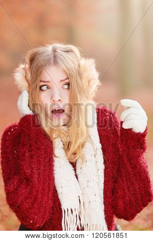 Scared Afraid Pretty Woman In Earmuffs.