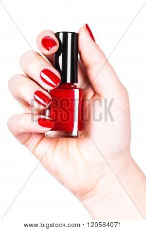 Red Nail Polish In A Hand