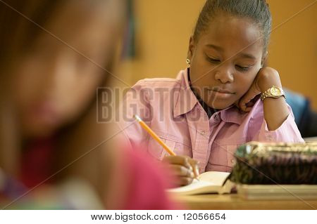 Young girl working in classroom