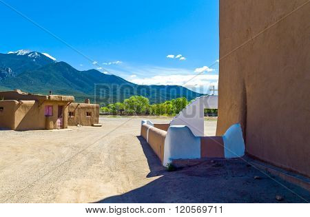 Taos, U.S.A. - May 22, 2011:The restored native pueblo seen from the St.Jerome church.