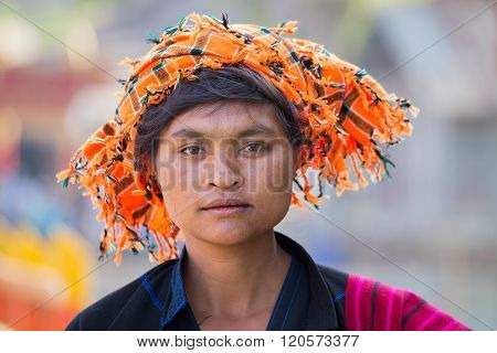 INLE LAKE MYANMAR - JANUARY 13 2016: Unidentified woman in market. The local people are hospitable and friendly to tourists