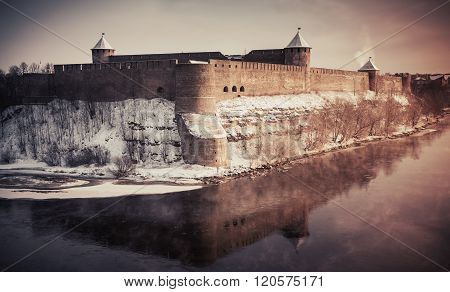 Ivangorod Fortress At Narva River In Winter
