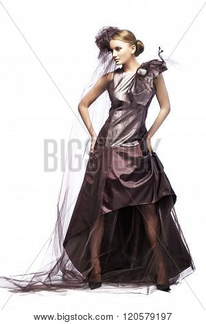 Beautiful tall girl dressed in expensive dresses.