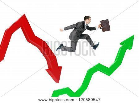 Businessman hopping arrows