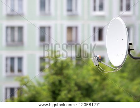Satellite Dish On The Background Of An Apartment House