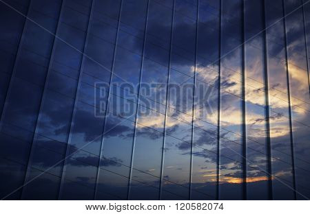 Reflection Of Sunset Sky In Metal Wall Of Office Building