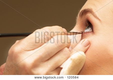 woman doing make-up poster