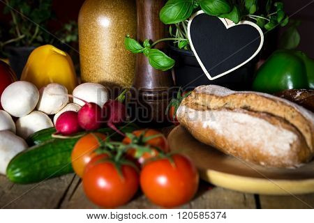 A Lots Of Vegetables And Bread On A Wooden Table, Heart With Copyspace