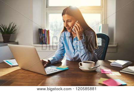 Woman Working On Laptop At Office