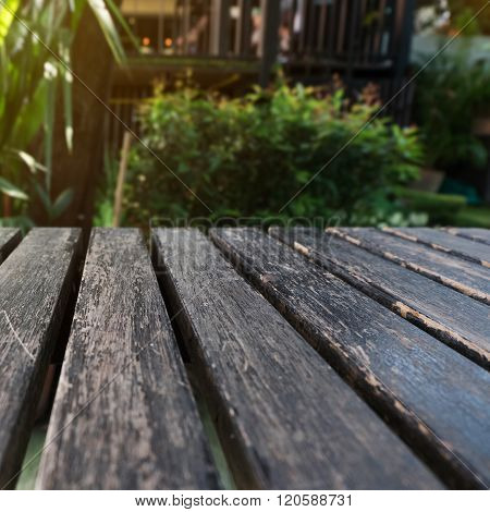 Old Table Wood Plank With Green Natural Blurred Background
