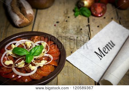 Tomato And Onion Salad On A Old Wooden Table, Scroll With Word Menu