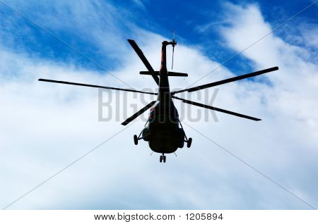 Helicopter, Sky And Clouds