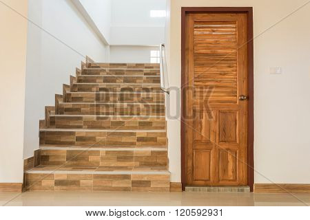 Staircase And Wood Door
