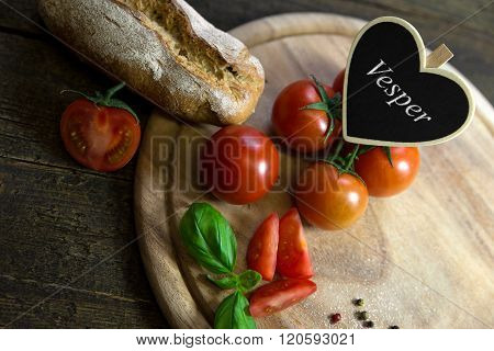 Tomatoes, Basil And Bread On A Wooden Table, Heart With Text Vesper