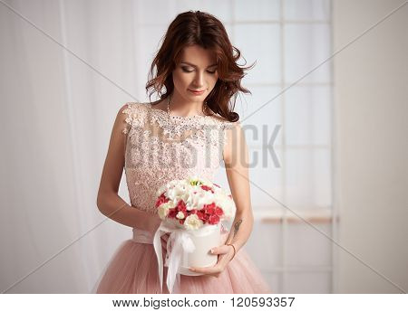 Bride in a pink dress with flowers