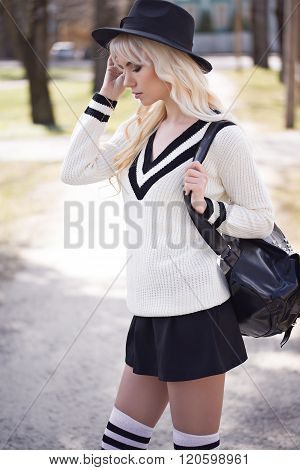 Portrait Of Blonde Young Woman Outdoors