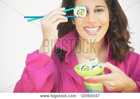 Young woman holding chopsticks