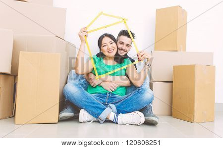 Young Couple Moving Into New House