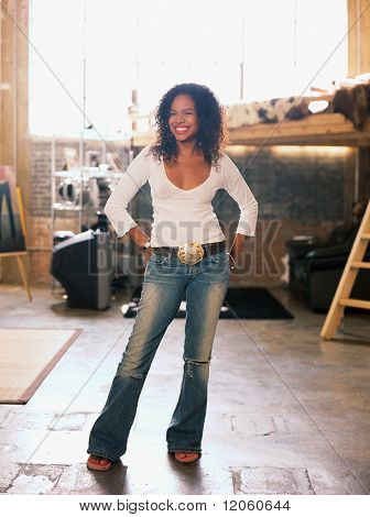 Young woman standing in warehouse